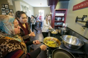 Duke students joined local refugees and their children at the Durham Spirits Company in east Durham to prepare a meal of traditional foods from Iraq and Sudan The event was part of the Food, Ethics, and Culture series at the Kenan Institute for Ethics