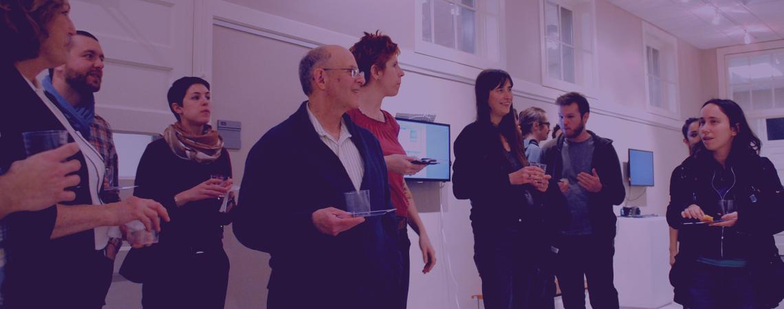 people talking at GAF exhibit opening, 2014