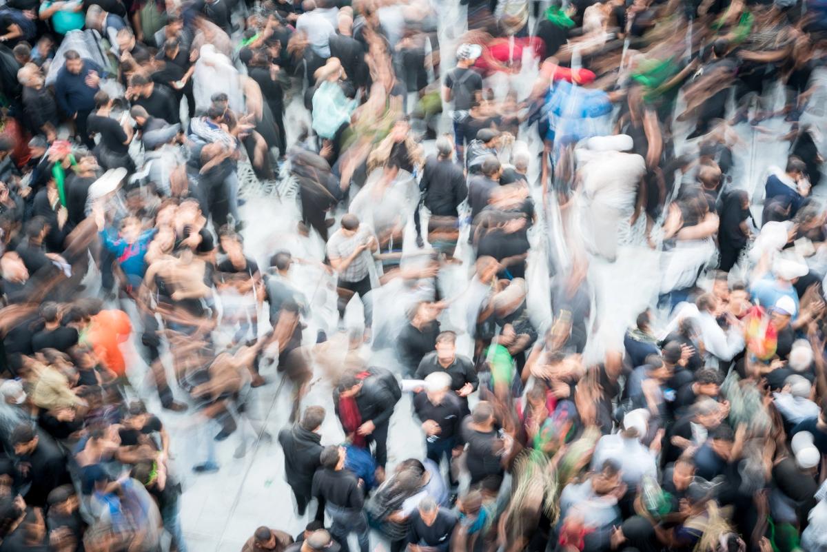 Long exposure image of people in a busy walkway
