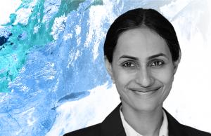 Headshot of Radhika Khosla against blue, green, and white background